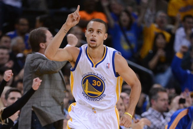 November 14, 2013; Oakland, CA, USA; Golden State Warriors point guard Stephen Curry (30) celebrates after making a basket against the Oklahoma City Thunder during the first quarter at Oracle Arena. Mandatory Credit: Kyle Terada-USA TODAY Sports