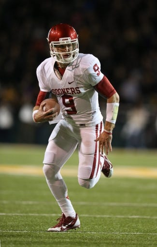 Nov 7, 2013; Waco, TX, USA; Oklahoma Sooners quarterback Trevor Knight (9) runs with the ball against the Baylor Bears at Floyd Casey Stadium. Mandatory Credit: Matthew Emmons-USA TODAY Sports