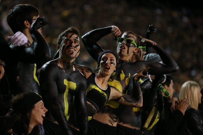 Nov 7, 2013; Waco, TX, USA; Baylor Bears students show off their muscles during the game against the Oklahoma Sooners at Floyd Casey Stadium. Mandatory Credit: Matthew Emmons-USA TODAY Sports