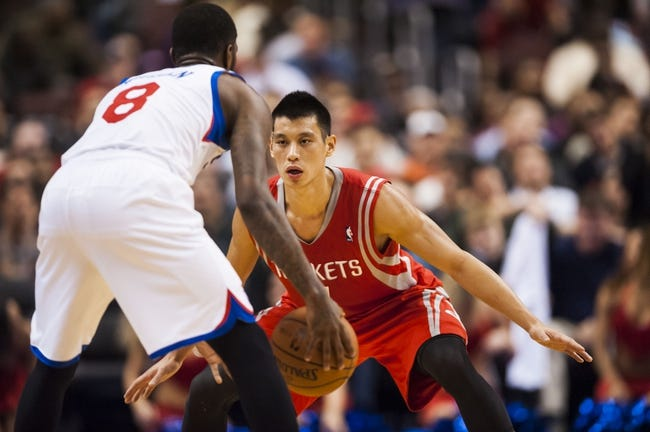 Nov 13, 2013; Philadelphia, PA, USA; Houston Rockets guard Jeremy Lin (7) defends the dribble of Philadelphia 76ers guard Tony Wroten (8) during the second quarter at Wells Fargo Center. The Sixers defeated the Rockets 123-117. Mandatory Credit: Howard Smith-USA TODAY Sports