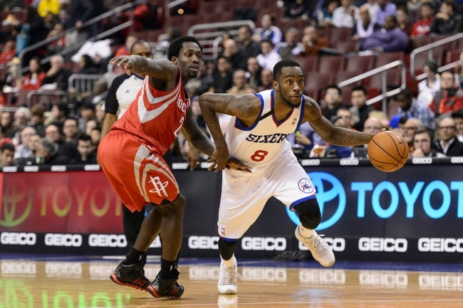 Nov 13, 2013; Philadelphia, PA, USA; Philadelphia 76ers guard Tony Wroten (8) is defended by Houston Rockets guard Patrick Beverley (2) during the third quarter at Wells Fargo Center. The Sixers defeated the Rockets 123-117. Mandatory Credit: Howard Smith-USA TODAY Sports