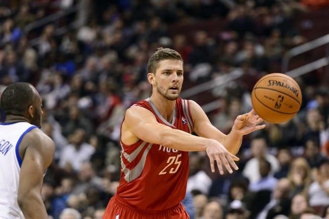 Nov 13, 2013; Philadelphia, PA, USA; Houston Rockets forward Chandler Parsons (25) passes the ball under pressure from Philadelphia 76ers guard James Anderson (9) during the fourth quarter at Wells Fargo Center. The Sixers defeated the Rockets 123-117. Mandatory Credit: Howard Smith-USA TODAY Sports