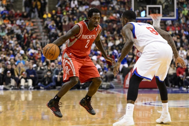 Nov 13, 2013; Philadelphia, PA, USA; Houston Rockets guard Patrick Beverley (2) is defended by Philadelphia 76ers guard Tony Wroten (8) during the fourth quarter at Wells Fargo Center. The Sixers defeated the Rockets 123-117. Mandatory Credit: Howard Smith-USA TODAY Sports