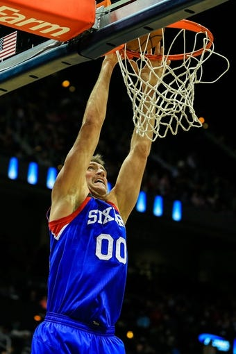 Nov 15, 2013; Atlanta, GA, USA; Philadelphia 76ers center Spencer Hawes (00) dunks in the first quarter against the Atlanta Hawks at Philips Arena. Mandatory Credit: Daniel Shirey-USA TODAY Sports