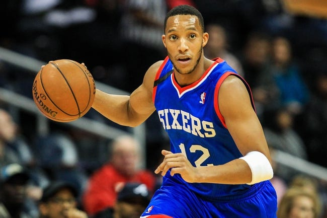 Nov 15, 2013; Atlanta, GA, USA; Philadelphia 76ers small forward Evan Turner (12) takes the ball down court in the first quarter against the Atlanta Hawks at Philips Arena. Mandatory Credit: Daniel Shirey-USA TODAY Sports