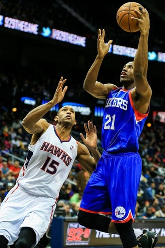 Nov 15, 2013; Atlanta, GA, USA; Philadelphia 76ers power forward Thaddeus Young (21) shoots a basket over Atlanta Hawks center Al Horford (15) in the first quarter at Philips Arena. Mandatory Credit: Daniel Shirey-USA TODAY Sports