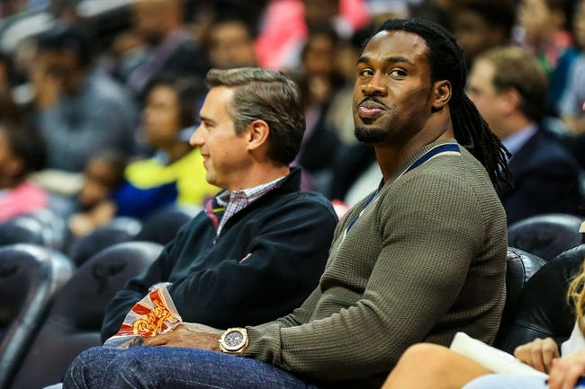 Nov 15, 2013; Atlanta, GA, USA; Atlanta Falcons running back Steven Jackson (39) sits court side in the first quarter between the Philadelphia 76ers and the Atlanta Hawks at Philips Arena. Mandatory Credit: Daniel Shirey-USA TODAY Sports