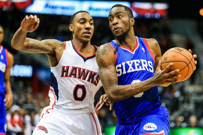 Nov 15, 2013; Atlanta, GA, USA; Philadelphia 76ers shooting guard Tony Wroten (8) drives to the basket past Atlanta Hawks point guard Jeff Teague (0) in the first quarter at Philips Arena. Mandatory Credit: Daniel Shirey-USA TODAY Sports