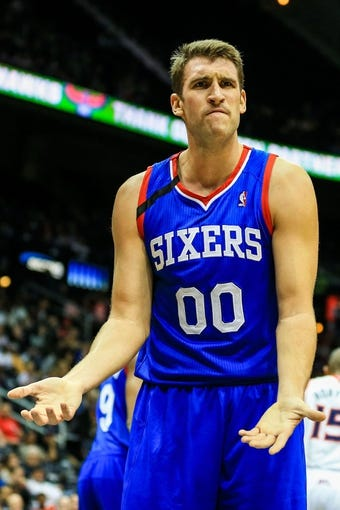 Nov 15, 2013; Atlanta, GA, USA; Philadelphia 76ers center Spencer Hawes (00) reacts to a foul call in the first quarter against the Atlanta Hawks at Philips Arena. Mandatory Credit: Daniel Shirey-USA TODAY Sports