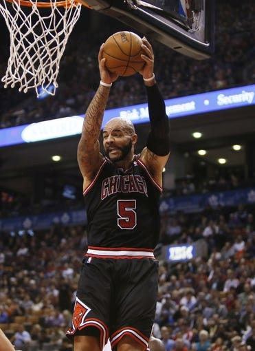 Nov 15, 2013; Toronto, Ontario, CAN; Chicago Bulls forward Carlos Boozer (5) comes down with a rebound against the Toronto Raptors during the first half at the Air Canada Centre. Mandatory Credit: John E. Sokolowski-USA TODAY Sports
