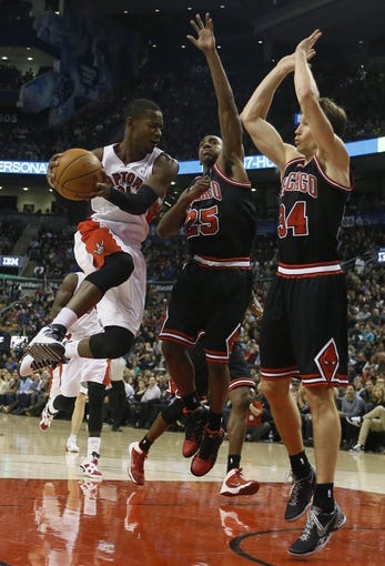 Nov 15, 2013; Toronto, Ontario, CAN; Toronto Raptors guard Terrence Ross (31) looks to pass the ball as Chicago Bulls guard Marquis Teague (25) and Chicago Bulls forward Mike Dunleavy (34) defend during the first half at the Air Canada Centre. Mandatory Credit: John E. Sokolowski-USA TODAY Sports