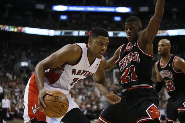 Nov 15, 2013; Toronto, Ontario, CAN; Toronto Raptors forward Rudy Gay (22) tries to drive to the net against Chicago Bulls guard-forward Jimmy Butler (21) during the first half at the Air Canada Centre. Mandatory Credit: John E. Sokolowski-USA TODAY Sports