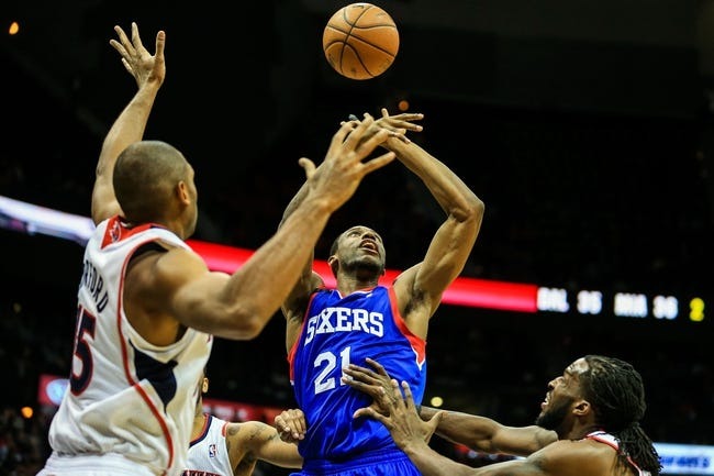 Nov 15, 2013; Atlanta, GA, USA; Philadelphia 76ers power forward Thaddeus Young (21) loses the ball in traffic in the first half against the Atlanta Hawks at Philips Arena. Mandatory Credit: Daniel Shirey-USA TODAY Sports