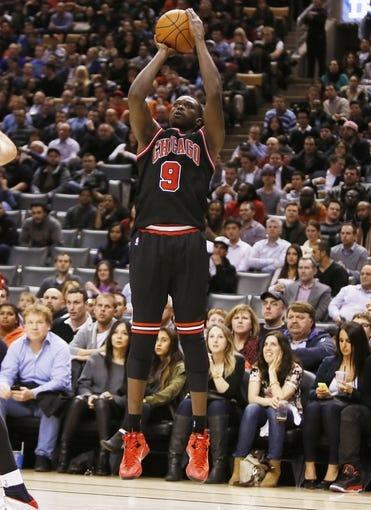 Nov 15, 2013; Toronto, Ontario, CAN; Chicago Bulls forward Luol Deng (9) shoots against the Toronto Raptors at the Air Canada Centre. Chicago defeated Toronto 96-80. Mandatory Credit: John E. Sokolowski-USA TODAY Sports