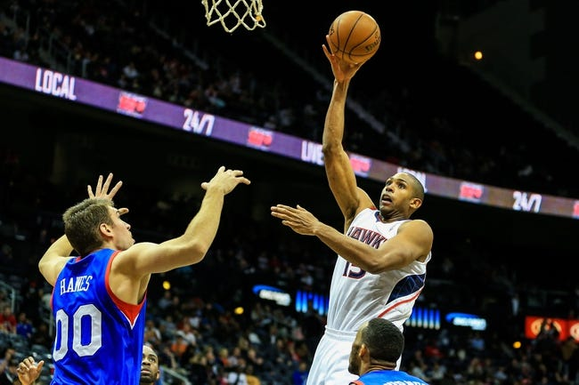 Nov 15, 2013; Atlanta, GA, USA; Atlanta Hawks center Al Horford (15) shoots a basket over Philadelphia 76ers center Spencer Hawes (00) in the second half at Philips Arena. The Hawks won 113-103. Mandatory Credit: Daniel Shirey-USA TODAY Sports