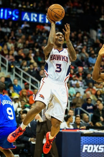 Nov 15, 2013; Atlanta, GA, USA; Atlanta Hawks shooting guard Louis Williams (3) shoots a basket in the second half against the Philadelphia 76ers at Philips Arena. The Hawks won 113-103. Mandatory Credit: Daniel Shirey-USA TODAY Sports