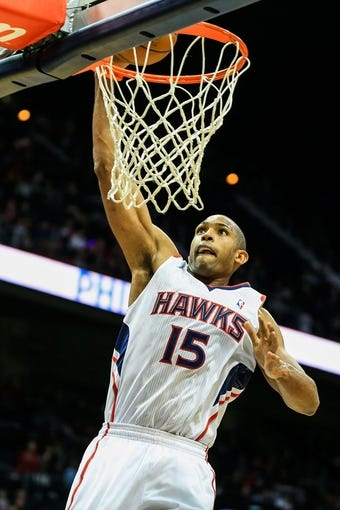 Nov 15, 2013; Atlanta, GA, USA; Atlanta Hawks center Al Horford (15) dunks in the second half against the Philadelphia 76ers at Philips Arena. The Hawks won 113-103. Mandatory Credit: Daniel Shirey-USA TODAY Sports