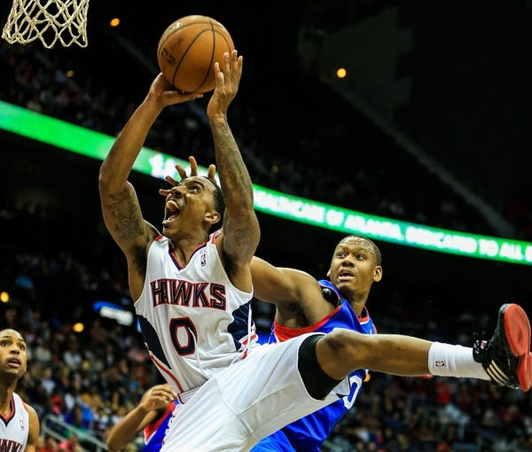 Nov 15, 2013; Atlanta, GA, USA; Atlanta Hawks point guard Jeff Teague (0) shoots a basket over Philadelphia 76ers power forward Lavoy Allen (50) in the second half at Philips Arena. The Hawks won 113-103. Mandatory Credit: Daniel Shirey-USA TODAY Sports