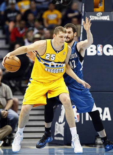 Nov 15, 2013; Denver, CO, USA; Minnesota Timberwolves power forward Kevin Love (42) guards Denver Nuggets center Timofey Mozgov (25) in the third quarter at the Pepsi Center. The Nuggets won 117-113. Mandatory Credit: Isaiah J. Downing-USA TODAY Sports