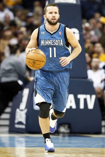 Nov 15, 2013; Denver, CO, USA; Minnesota Timberwolves point guard J.J. Barea (11) controls the ball in the third quarter against the Denver Nuggets at the Pepsi Center. The Nuggets won 117-113. Mandatory Credit: Isaiah J. Downing-USA TODAY Sports