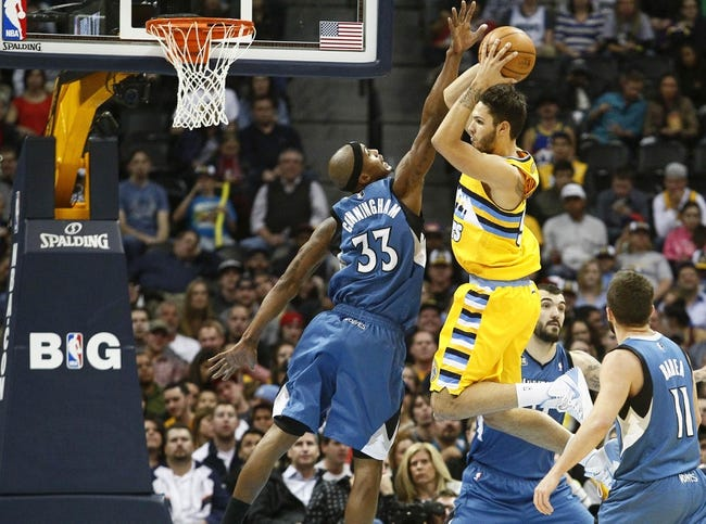Nov 15, 2013; Denver, CO, USA; Minnesota Timberwolves power forward Dante Cunningham (33) guards Denver Nuggets shooting guard Evan Fournier (94) in the fourth quarter at the Pepsi Center. The Nuggets won 117-113. Mandatory Credit: Isaiah J. Downing-USA TODAY Sports