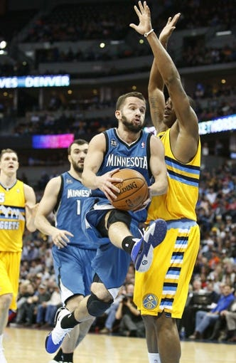 Nov 15, 2013; Denver, CO, USA; Denver Nuggets power forward Darrell Arthur (00) guards Minnesota Timberwolves point guard J.J. Barea (11) in the fourth quarter at the Pepsi Center. The Nuggets won 117-113. Mandatory Credit: Isaiah J. Downing-USA TODAY Sports
