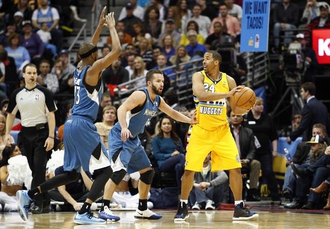 Nov 15, 2013; Denver, CO, USA; Minnesota Timberwolves small forward Corey Brewer (13) and point guard J.J. Barea (11) pressure Denver Nuggets point guard Andre Miller (24) in the fourth quarter at the Pepsi Center. The Nuggets won 117-113. Mandatory Credit: Isaiah J. Downing-USA TODAY Sports