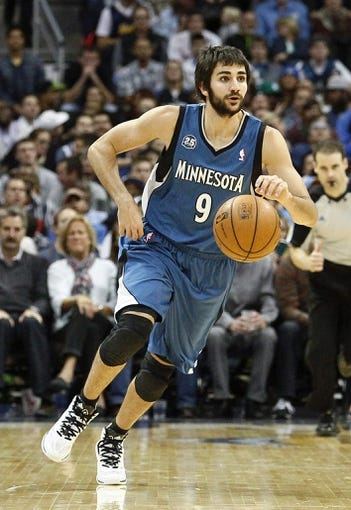 Nov 15, 2013; Denver, CO, USA; Minnesota Timberwolves point guard Ricky Rubio (9) controls the ball in the fourth quarter against the Denver Nuggets at the Pepsi Center. The Nuggets won 117-113. Mandatory Credit: Isaiah J. Downing-USA TODAY Sports
