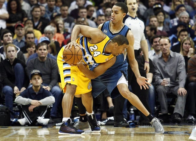 Nov 15, 2013; Denver, CO, USA; Minnesota Timberwolves shooting guard Kevin Martin (23) guards Denver Nuggets point guard Andre Miller (24) in the fourth quarter at the Pepsi Center. The Nuggets won 117-113. Mandatory Credit: Isaiah J. Downing-USA TODAY Sports