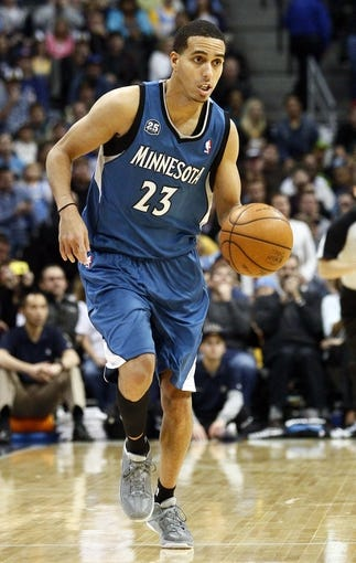 Nov 15, 2013; Denver, CO, USA; Minnesota Timberwolves shooting guard Kevin Martin (23) controls the ball in the fourth quarter against the Denver Nuggets at the Pepsi Center. The Nuggets won 117-113. Mandatory Credit: Isaiah J. Downing-USA TODAY Sports