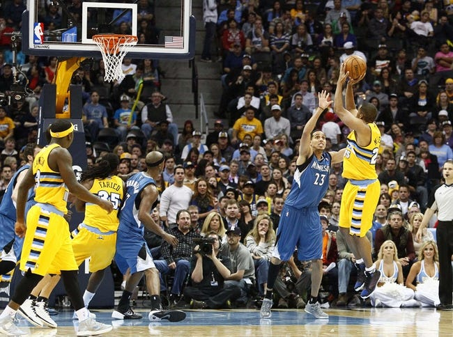 Nov 15, 2013; Denver, CO, USA; Denver Nuggets point guard Andre Miller (24) takes a shot against Minnesota Timberwolves shooting guard Kevin Martin (23) in the fourth quarter at the Pepsi Center. The Nuggets won 117-113. Mandatory Credit: Isaiah J. Downing-USA TODAY Sports
