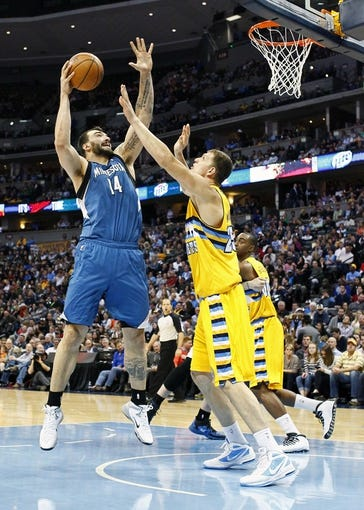 Nov 15, 2013; Denver, CO, USA; Denver Nuggets center Timofey Mozgov (25) guards Minnesota Timberwolves center Nikola Pekovic (14) in the third quarter at the Pepsi Center. The Nuggets won 117-113. Mandatory Credit: Isaiah J. Downing-USA TODAY Sports