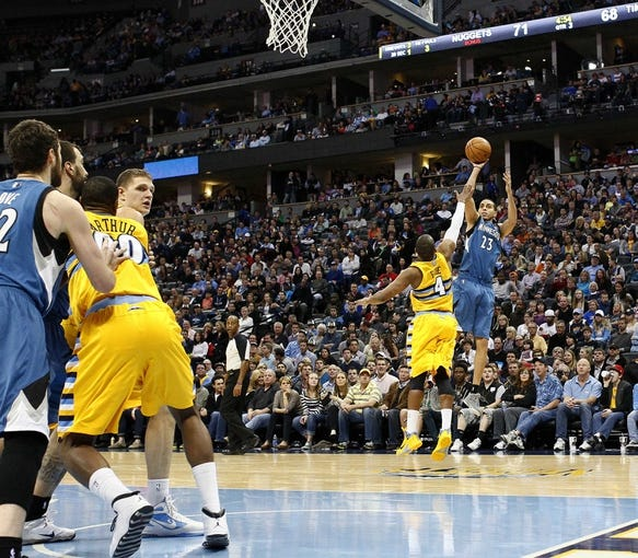 Nov 15, 2013; Denver, CO, USA; Minnesota Timberwolves shooting guard Kevin Martin (23) shoots the ball against Denver Nuggets point guard Randy Foye (4) in the third quarter at the Pepsi Center. The Nuggets won 117-113. Mandatory Credit: Isaiah J. Downing-USA TODAY Sports