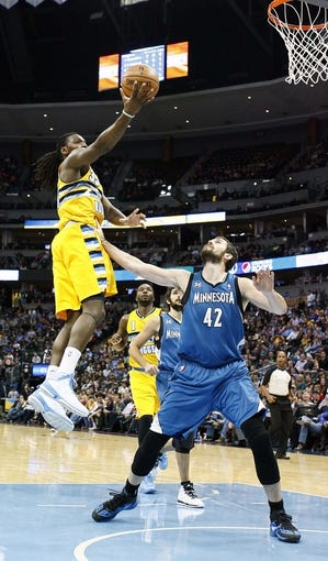 Nov 15, 2013; Denver, CO, USA; Minnesota Timberwolves power forward Kevin Love (42) guards Denver Nuggets small forward Kenneth Faried (35) in the second quarter at the Pepsi Center. The Nuggets won 117-113. Mandatory Credit: Isaiah J. Downing-USA TODAY Sports