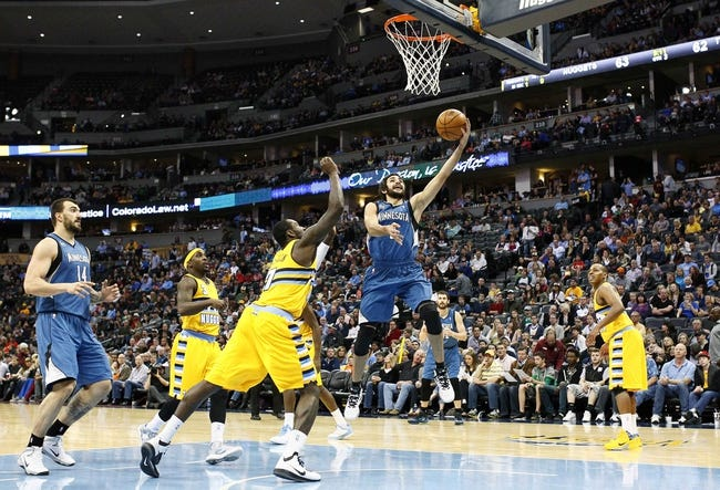 Nov 15, 2013; Denver, CO, USA; Minnesota Timberwolves center Nikola Pekovic (14) watches as point guard Ricky Rubio (9) takes a shot against Denver Nuggets power forward J.J. Hickson (7) in the third quarter at the Pepsi Center. The Nuggets won 117-113. Mandatory Credit: Isaiah J. Downing-USA TODAY Sports