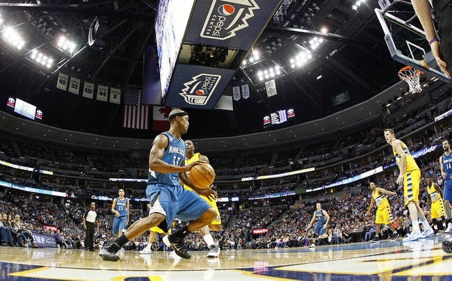 Nov 15, 2013; Denver, CO, USA; Denver Nuggets power forward Darrell Arthur (00) pressures Minnesota Timberwolves power forward Dante Cunningham (33) in the fourth quarter at the Pepsi Center. The Nuggets won 117-113. Mandatory Credit: Isaiah J. Downing-USA TODAY Sports