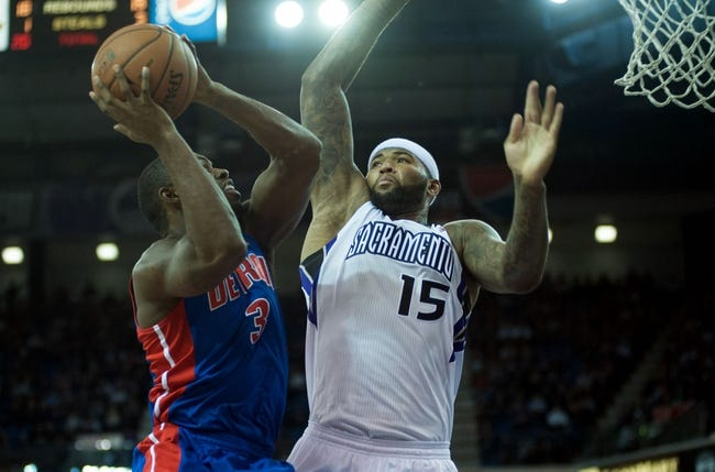Nov 15, 2013; Sacramento, CA, USA; Sacramento Kings center DeMarcus Cousins (15) attempts to block a shot by Detroit Pistons shooting guard Rodney Stuckey (3) during the second quarter at Sleep Train Arena. Mandatory Credit: Ed Szczepanski-USA TODAY Sports