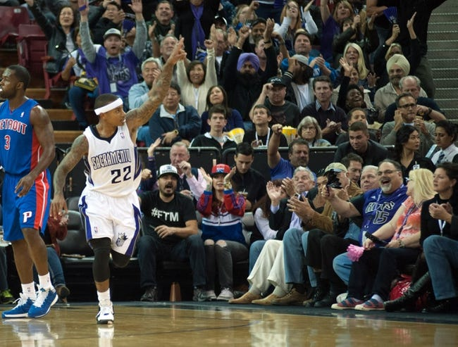 Nov 15, 2013; Sacramento, CA, USA; Sacramento Kings point guard Isaiah Thomas (22) points to the crowd after making a three pointer against the Detroit Pistons during the second quarter at Sleep Train Arena. Mandatory Credit: Ed Szczepanski-USA TODAY Sports