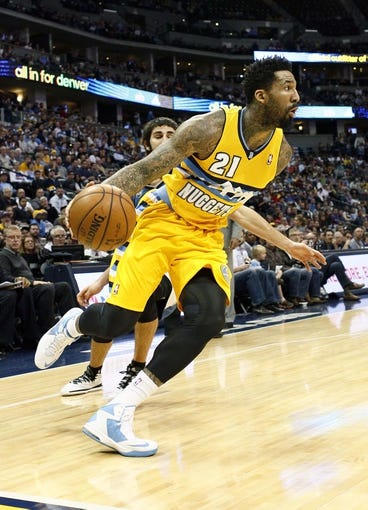 Nov 15, 2013; Denver, CO, USA; Denver Nuggets shooting guard Wilson Chandler (21) controls the ball in the second quarter against the Minnesota Timberwolves at the Pepsi Center. The Nuggets won 117-113. Mandatory Credit: Isaiah J. Downing-USA TODAY Sports