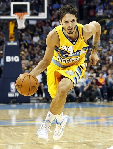 Nov 15, 2013; Denver, CO, USA; Denver Nuggets shooting guard Evan Fournier (94) controls the ball in the second quarter against the Minnesota Timberwolves at the Pepsi Center. The Nuggets won 117-113. Mandatory Credit: Isaiah J. Downing-USA TODAY Sports