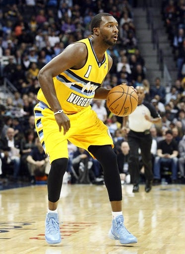 Nov 15, 2013; Denver, CO, USA; Denver Nuggets shooting guard Jordan Hamilton (1) controls the ball in the second quarter against the Minnesota Timberwolves at the Pepsi Center. The Nuggets won 117-113. Mandatory Credit: Isaiah J. Downing-USA TODAY Sports