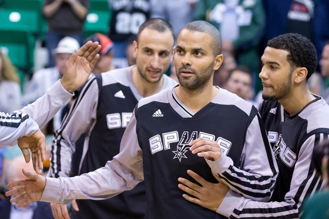 Nov 15, 2013; Salt Lake City, UT, USA; San Antonio Spurs point guard Tony Parker (9) is introduced prior to a game against the Utah Jazz at EnergySolutions Arena. San Antonio won 91-82. Mandatory Credit: Russ Isabella-USA TODAY Sports