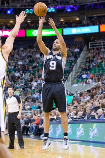 Nov 15, 2013; Salt Lake City, UT, USA; San Antonio Spurs point guard Tony Parker (9) shoots during the second half against the Utah Jazz at EnergySolutions Arena. San Antonio won 91-82. Mandatory Credit: Russ Isabella-USA TODAY Sports
