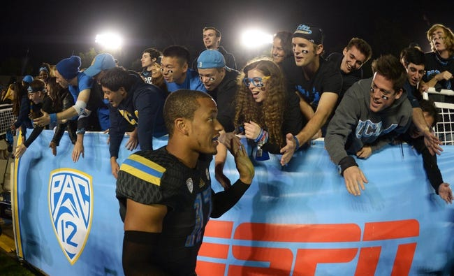 Nov 15, 2013; Pasadena, CA, USA; UCLA Bruins quarterback Brett Hundley (17) celebrates with fans after the game against the Washington Huskies at Rose Bowl. Mandatory Credit: Kirby Lee-USA TODAY Sports