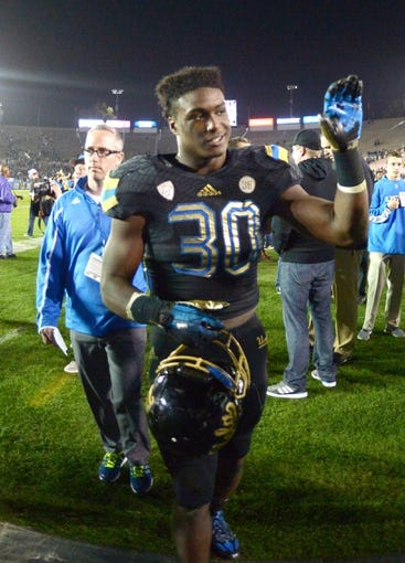 Nov 15, 2013; Pasadena, CA, USA; UCLA Bruins running back Myles Jack (30) celebrates after the game against the Washington Huskies at Rose Bowl. Mandatory Credit: Kirby Lee-USA TODAY Sports