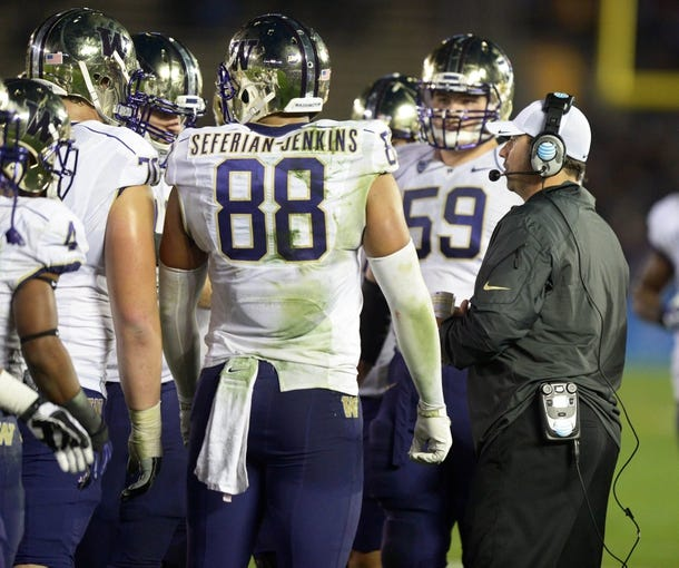 Nov 15, 2013; Pasadena, CA, USA; Washington Huskies coach Steve Sarkisian talks with players Austin Seferian-Jenkins (88) and Ben Riva (59) during the game against the UCLA Bruins at Rose Bowl. UCLA defeated Washington 41-31.  Mandatory Credit: Kirby Lee-USA TODAY Sports