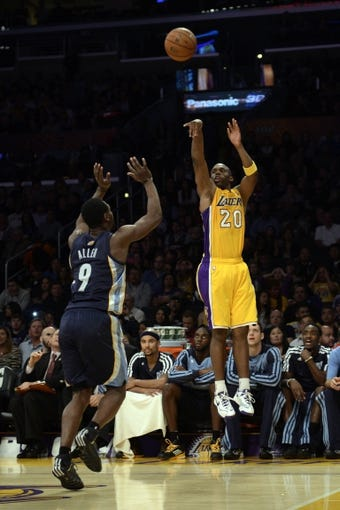 Nov 15, 2013; Los Angeles, CA, USA; Los Angeles Lakers guard Jodie Meeks (20) attempts a shot against the Memphis Grizzlies during the third quarter at Staples Center. The Memphis Grizzlies defeated the Los Angeles Lakers 89-86. Mandatory Credit: Kelvin Kuo-USA TODAY Sports