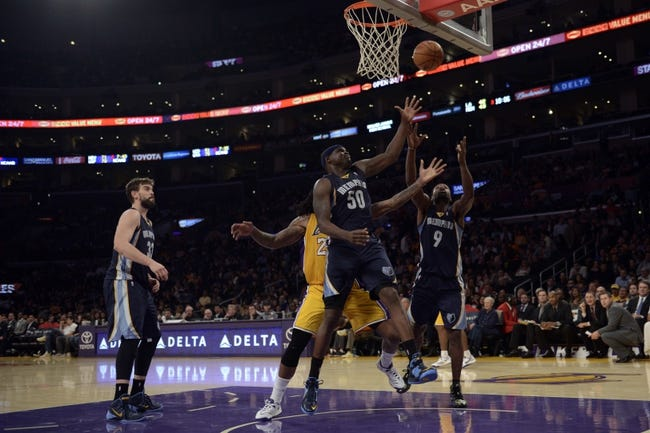 Nov 15, 2013; Los Angeles, CA, USA; Memphis Grizzlies forward Zach Randolph (50) and guard Tony Allen (9) and Los Angeles Lakers center Jordan Hill (27) battle for the rebound during the third quarter at Staples Center. The Memphis Grizzlies defeated the Los Angeles Lakers 89-86. Mandatory Credit: Kelvin Kuo-USA TODAY Sports