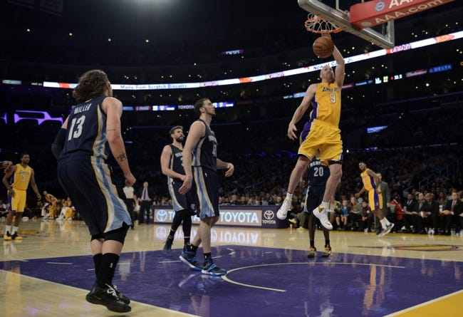 Nov 15, 2013; Los Angeles, CA, USA; Los Angeles Lakers center Chris Kaman (9) dunks the ball against the Memphis Grizzlies during the third quarter at Staples Center. The Memphis Grizzlies defeated the Los Angeles Lakers 89-86. Mandatory Credit: Kelvin Kuo-USA TODAY Sports