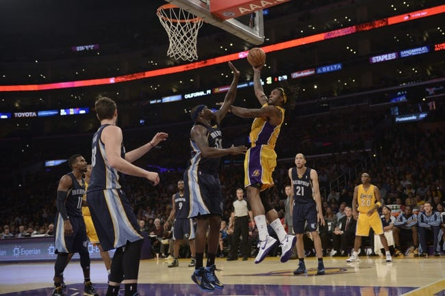 Nov 15, 2013; Los Angeles, CA, USA; Los Angeles Lakers center Jordan Hill (27) attempts a shot defended by Memphis Grizzlies forward Zach Randolph (50) during the third quarter at Staples Center. The Memphis Grizzlies defeated the Los Angeles Lakers 89-86. Mandatory Credit: Kelvin Kuo-USA TODAY Sports